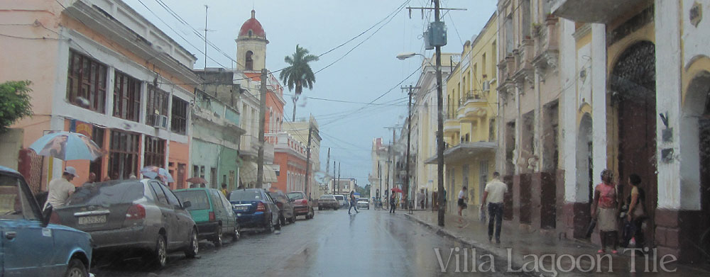 An afternoon shower in Cienfuegos, Cuba. We ducked into a toy shop, as did many others trying to avoid getting drenched.