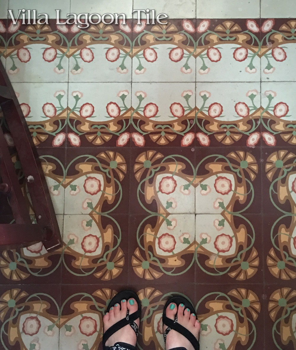 Art Nouveau styled floral floor of cement tile in Havana with a double border.
